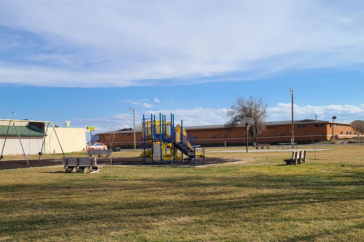 Boardman City Park Playground, swing set, and field.
