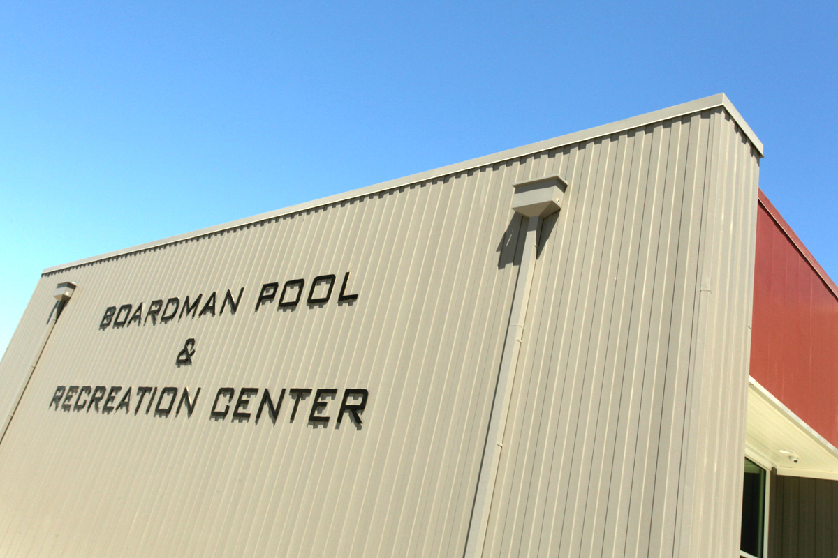The front of Boadman Pool & Recreational Center's building and facility sign.