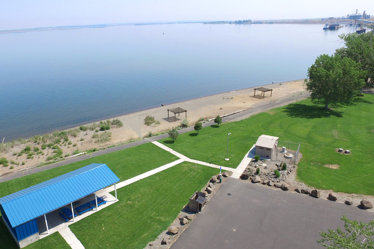 Marker 40 Boardman Marina Park aerial view of green lawns, pavilion, and beach.