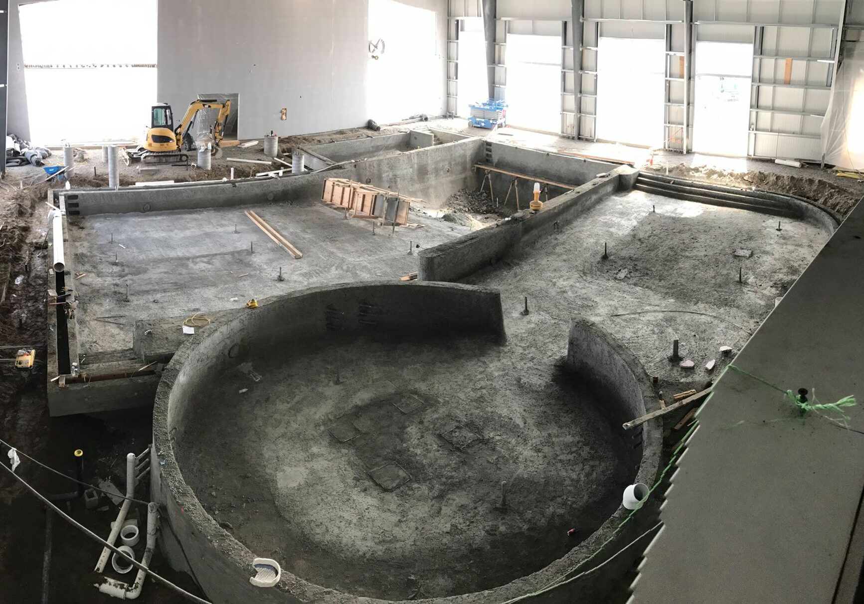 Pool Construction, pouring concrete to form the vortex and other pools.
